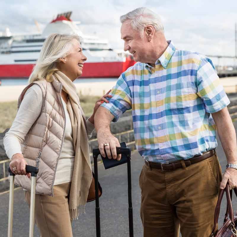 Couple with hearing aids going on vacation