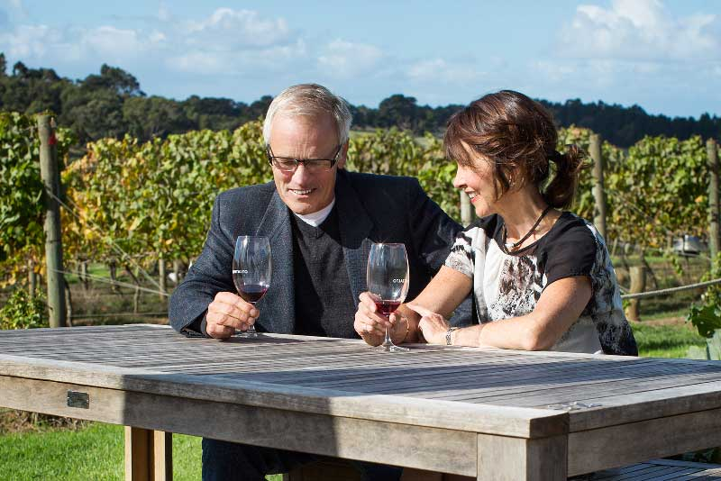 Hearing loss couple with hearing aids at winery
