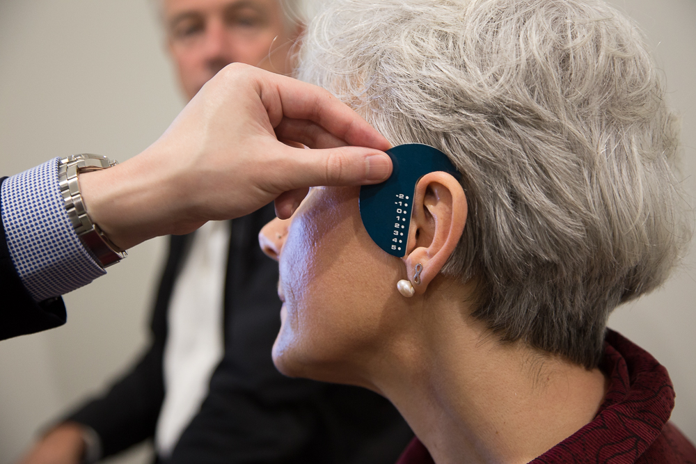 Woman getting fitted for hearing aid