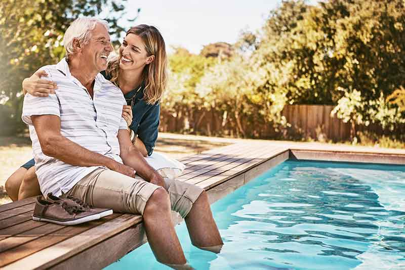 father with hearing loss and daughter by pool
